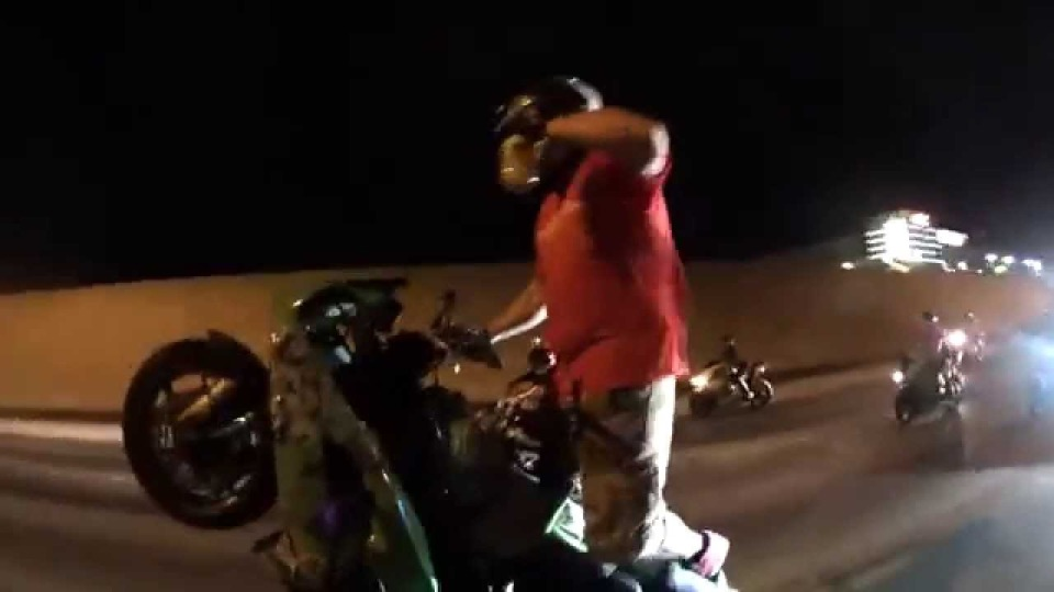 Crazy stunt rider drinks a 40oz while riding wheelie down highway