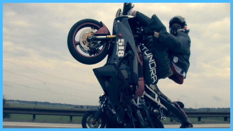 Stunt Rider Wheelies With Feet Over Winshield