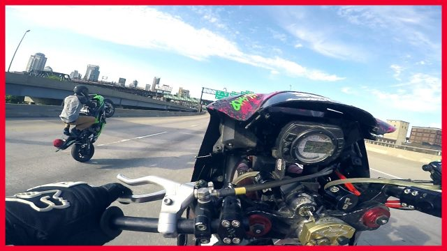 MOTORCYCLE STUNTS Riders Do Wheelies on Highway 2016